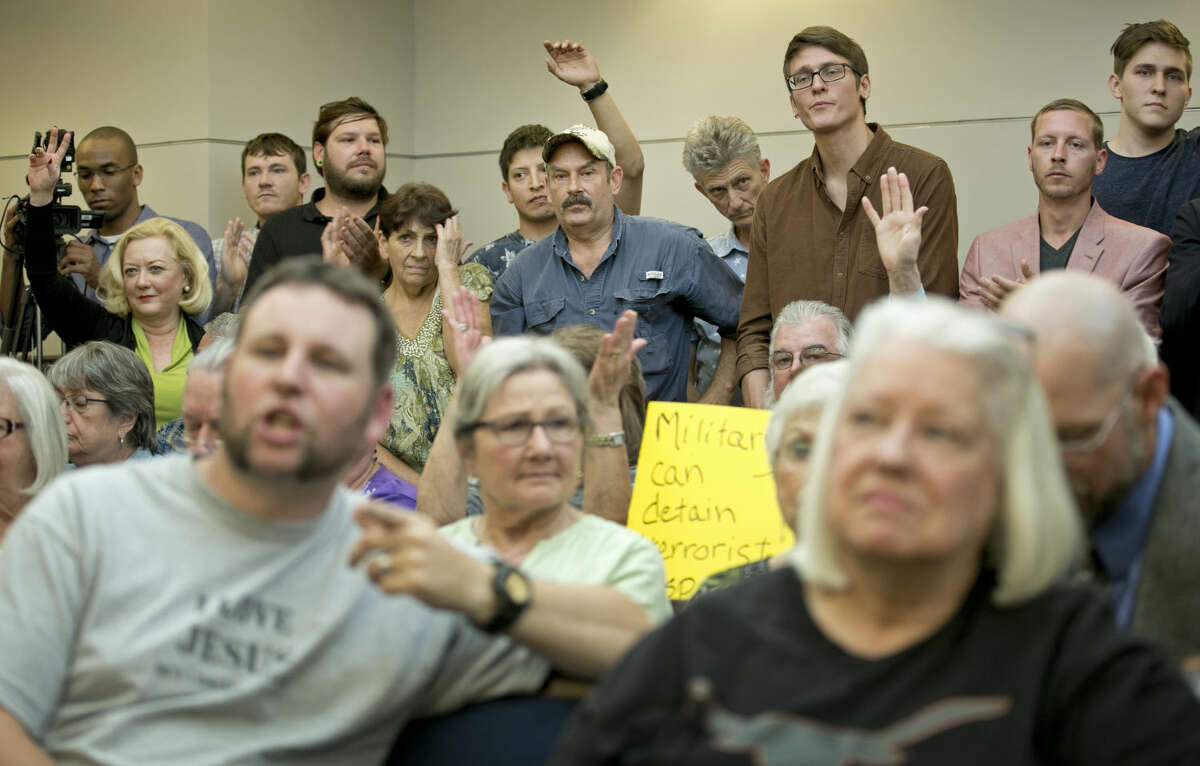 People listen at a public hearing about the Jade Helm 15 military training exercise in Bastrop, Texas, Monday April 27, 2015. (Jay Janner/Austin American-Statesman via AP) AUSTIN CHRONICLE OUT, COMMUNITY IMPACT OUT, INTERNET AND TV MUST CREDIT PHOTOGRAPHER AND STATESMAN.COM, MAGS OUT