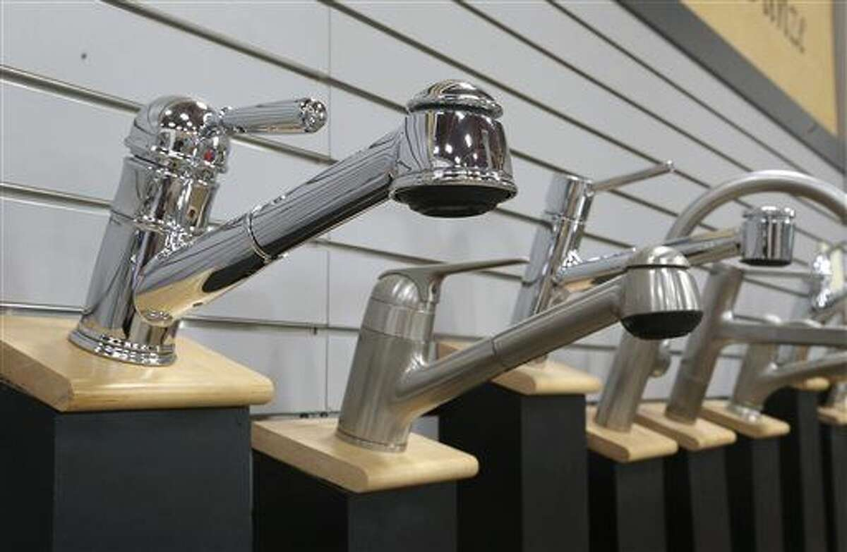A variety of kitchen faucets are displayed at the Brothers Plumbing Store in Sacramento, Calif., Thursday, April 9, 2015. In response to Gov. Jerry Browns executive order last week,imposing sweeping water-saving measures California regulators are speeding up water-efficiency standards for faucets and urinals in response to the drought. Previously faucets were allowed to pour 2.2 gallons a minute: the updated standards, to take effect in January 2016, have been lowered to 1.2 for home bathrooms, 1.8 for kitchens and a half gallon for public bathrooms.(AP Photo/Rich Pedroncelli)