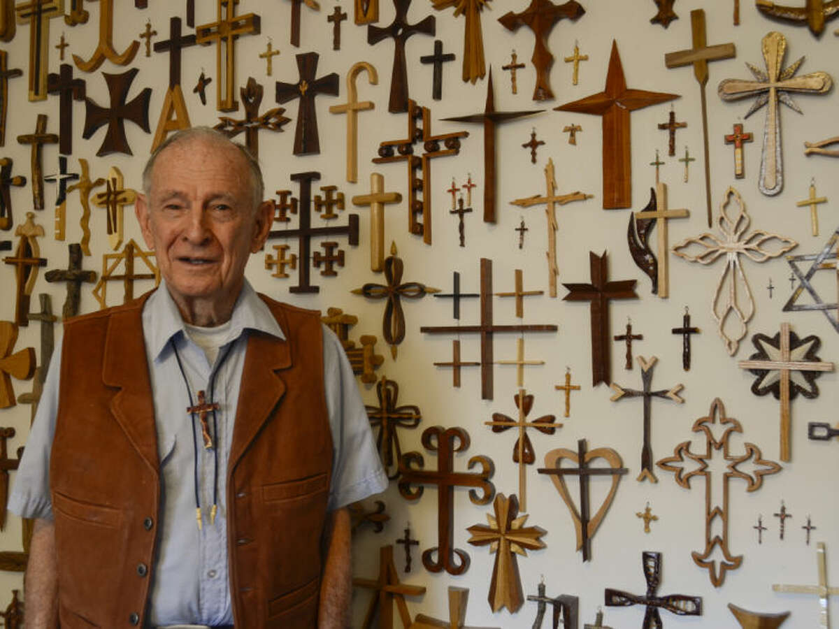 Fred Meissner, former NASA engineer, hand carves wooden crosses and gives them away. Tim Fischer\Reporter-Telegram