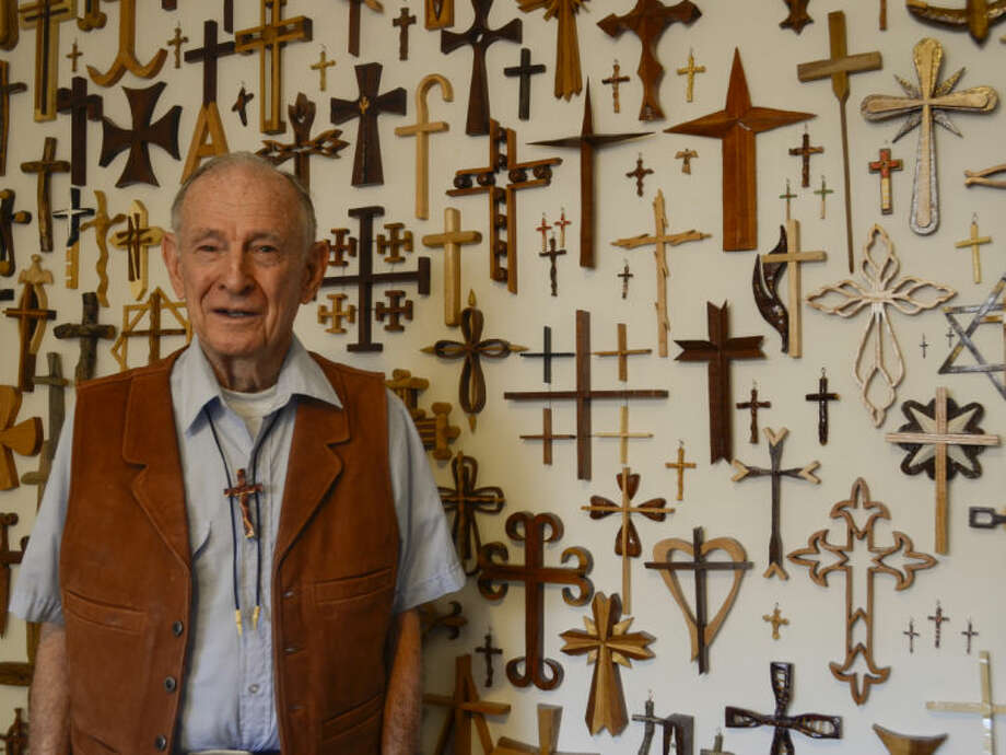 Fred Meissner, former NASA engineer, hand carves wooden crosses and gives them away. Tim Fischer\Reporter-Telegram Photo: Tim Fischer