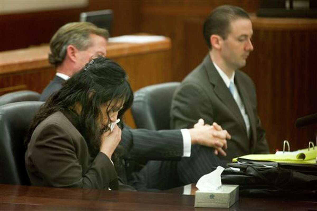 Ana Lilia Trujillo, left, reacts to hearing a 911 call during her trial Tuesday, April 1, 2014, in Houston. Trujillo, 45, is charged with murder, accused of killing her 59-year-old boyfriend, Alf Stefan Andersson with the heel of a stiletto shoe, at his Museum District high-rise condominium in June 2013. (AP Photo/Houston Chronicle, Brett Coomer) MANDATORY CREDIT