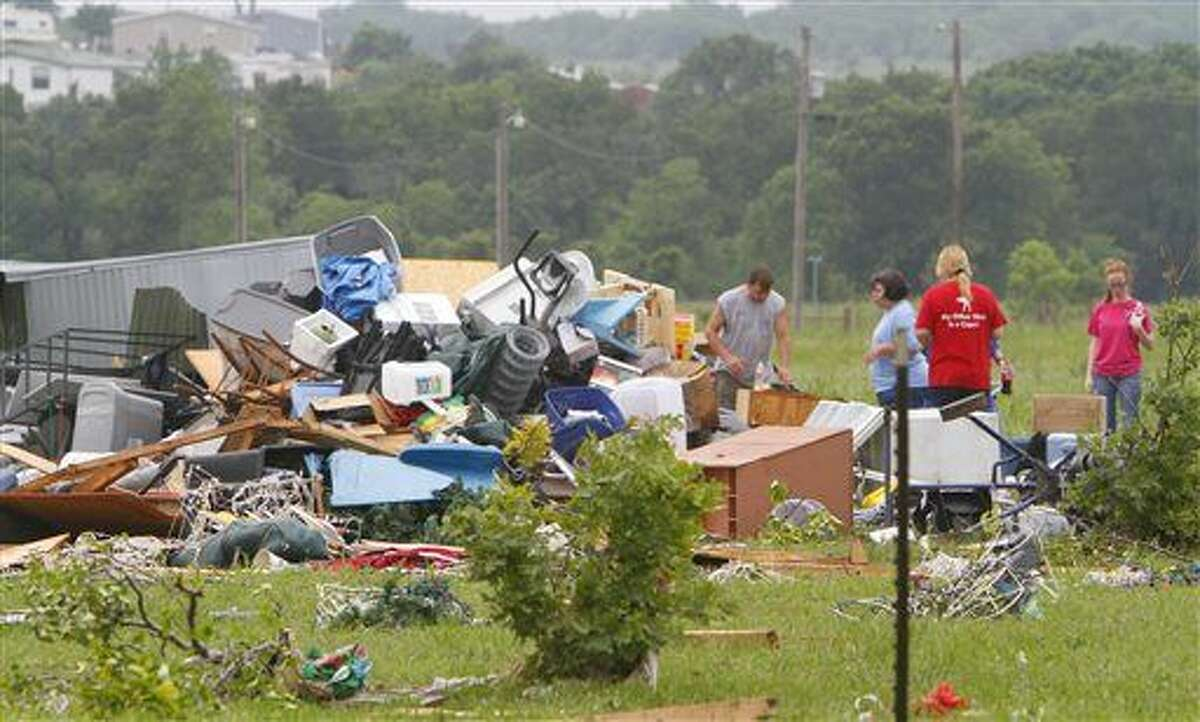 Neighbors and friends help clean up after Thursday night's tornado passed the area on Friday, May 8, 2015 in New Fairview, Texas. Strong storms spawned several tornadoes and dumped heavy rain on North Texas overnight, flooding roads and damaging train tracks in an area where a freight train derailed before dawn on Friday, officials said. (David Kent/The Fort Worth Star-Telegram via AP) MAGS OUT; (FORT WORTH WEEKLY, 360 WEST); INTERNET OUT