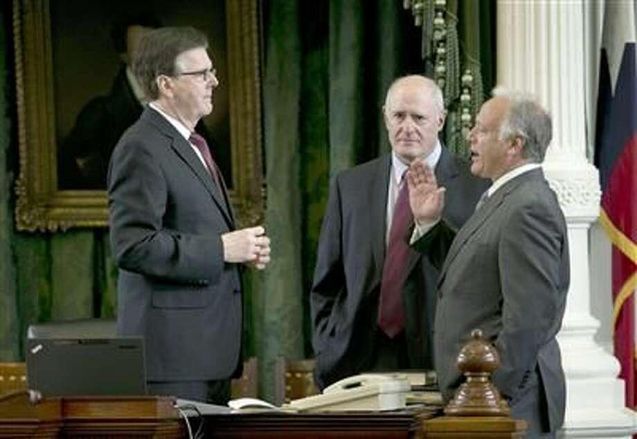 Lt. Gov. Dan Patrick (from left), Sen. Kel Seliger and Sen. Kirk Watson talk in the Senate chamber at the Capitol in Austin.