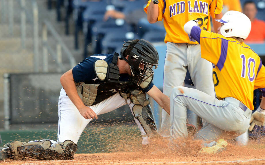 Midland High's Ethan Barker scores after stealing home against Arlington Lamar during a Class 6A bi-district playoff game Friday, May 8, 2015. James Durbin/Reporter-Telegram Photo: James Durbin