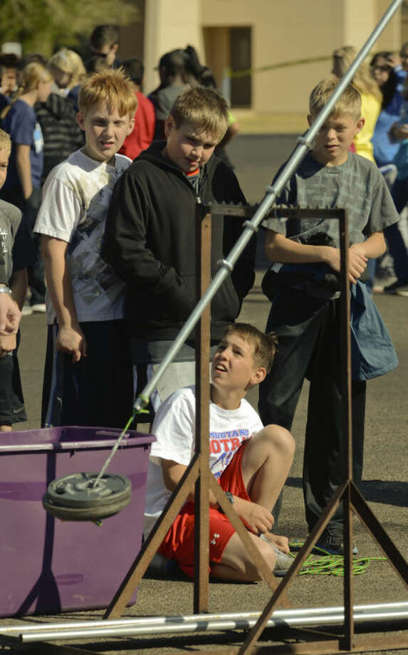 Jake Thompson, 5th grader at Midland Christian, watches along with his classmates as he launches a water bolloon with a trebuchet Friday at Midland College Science Extravaganza. Tim Fischer\Reporter-Telegram 4-12-13 Photo: Tim Fischer
