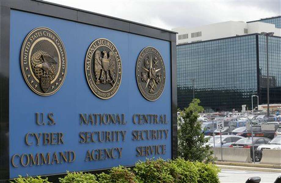 FILE - In this June 6, 2013 file photo, a sign stands outside the National Security Agency (NSA) campus in Fort Meade, Md. As Congress considers whether to extend the life of a government program that sweeps up American phone records, privacy advocates and civil liberties group fear too much about the surveillance still remains hidden from view to allow for a comprehensive public understanding. (AP Photo/Patrick Semansky, File) Photo: Patrick Semansky