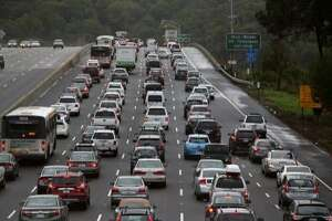 MILL VALLEY, CA - DECEMBER 03:  Cars sit in miles-long traffic jam on southbound highway 101 as they approach a flooded section of the freeway on December 3, 2014 in Mill Valley, California. The San Francisco Bay Area is being hit with its first major storm of the year that is bringing heavy rain, lightning and hail to the region. The heavy overnight rain has caused flooding which has blocked several roadways and caused severe traffic backups.  (Photo by Justin Sullivan/Getty Images)