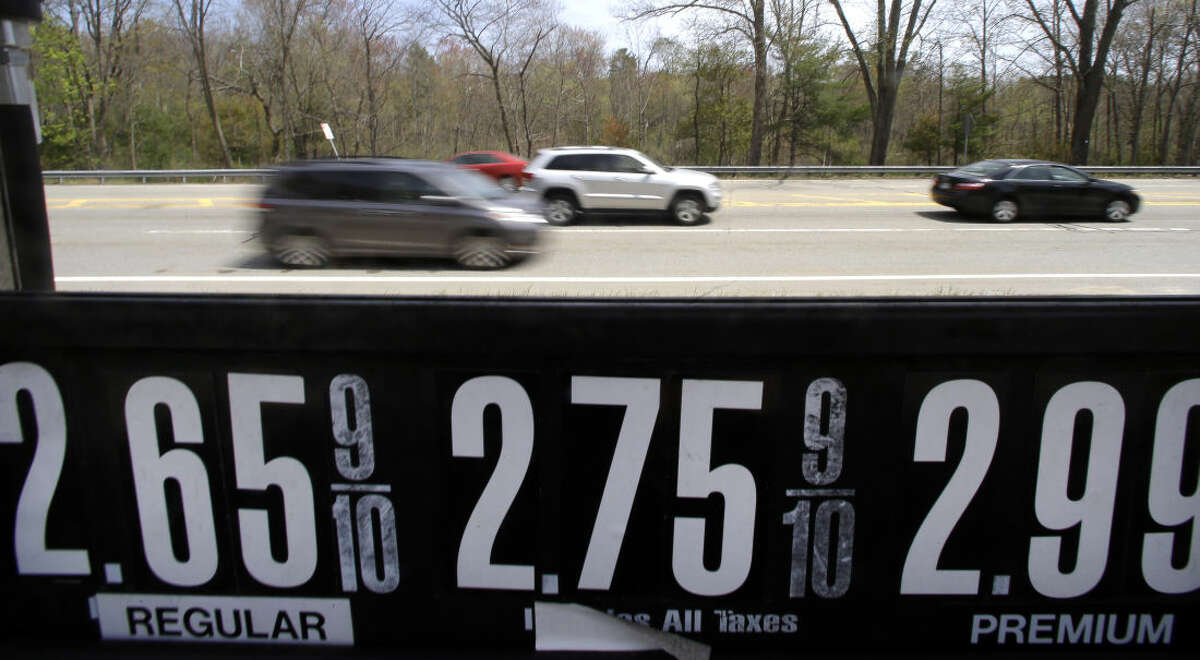 Vehicles drive past a gas station in Andover, Mass., Friday, May 8, 2015. With more money in their pockets thanks to lower gas prices and an improved job market, AAA expects more than 37 million Americans to travel for Memorial Day, the most since 2005. (AP Photo/Elise Amendola)
