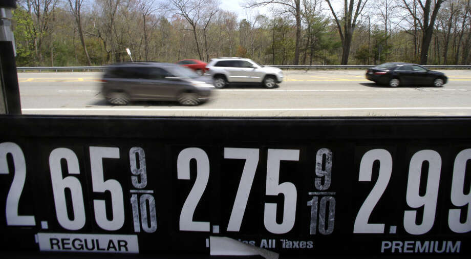 Vehicles drive past a gas station in Andover, Mass., Friday, May 8, 2015. With more money in their pockets thanks to lower gas prices and an improved job market, AAA expects more than 37 million Americans to travel for Memorial Day, the most since 2005. (AP Photo/Elise Amendola) Photo: Elise Amendola