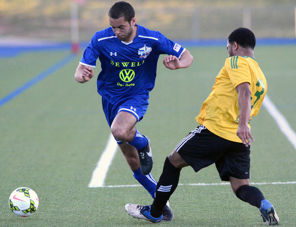 Sockers' Tory McKerrell moves the ball against Tulsa Athletics' Byron Knowles (3) on Wednesday, May 13, 2015 at Grande Communications Stadium. James Durbin/Reporter-Telegram