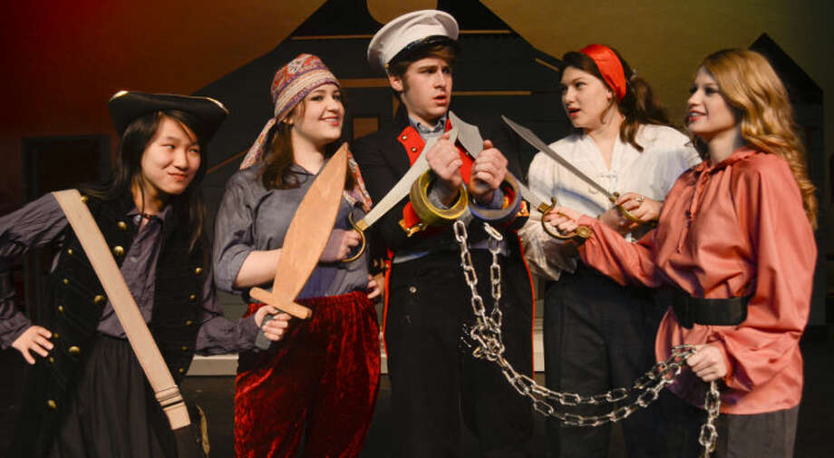 The Pirates, Sarah Friday, Amelia Amicarella, Kyle McDuffey and Savannah Cantwell capture Pippi's father, Elliot Brown, center, in Pickwick Players Pippi Longstocking. Tim Fischer\Reporter-Telegram Photo: Tim Fischer