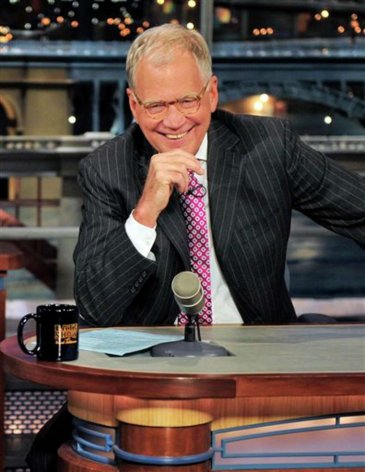 FILE - In this April 23, 2012 file photo provided by CBS, host David Letterman appears during a taping of his show