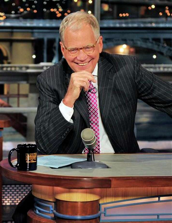 "FILE - In this April 23, 2012 file photo provided by CBS, host David Letterman appears during a taping of his show ""Late Show with David Letterman, in New York. Letterman says he plans to retire next year as host of ""Late Show."" During a taping of his show Thursday, April 3, 2014, Letterman said he has informed his CBS bosses that he will step down in 2015, when his current contract expires. He told his audience he expects his departure will be ""at least a year or so"" from now. (AP Photo/CBS, John Paul Filo) MANDATORY CREDIT; NO ARCHIVE; NO SALES; NORTH AMERICAN USE ONLY Photo: John Paul Filo / CBS"
