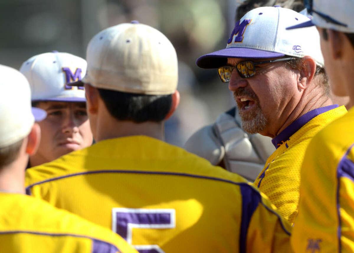 Midland High boys baseball head coach Barry Russell talks to his team during the game against Abilene High on Tuesday at Zachery Field. James Durbin/Reporter-Telegram