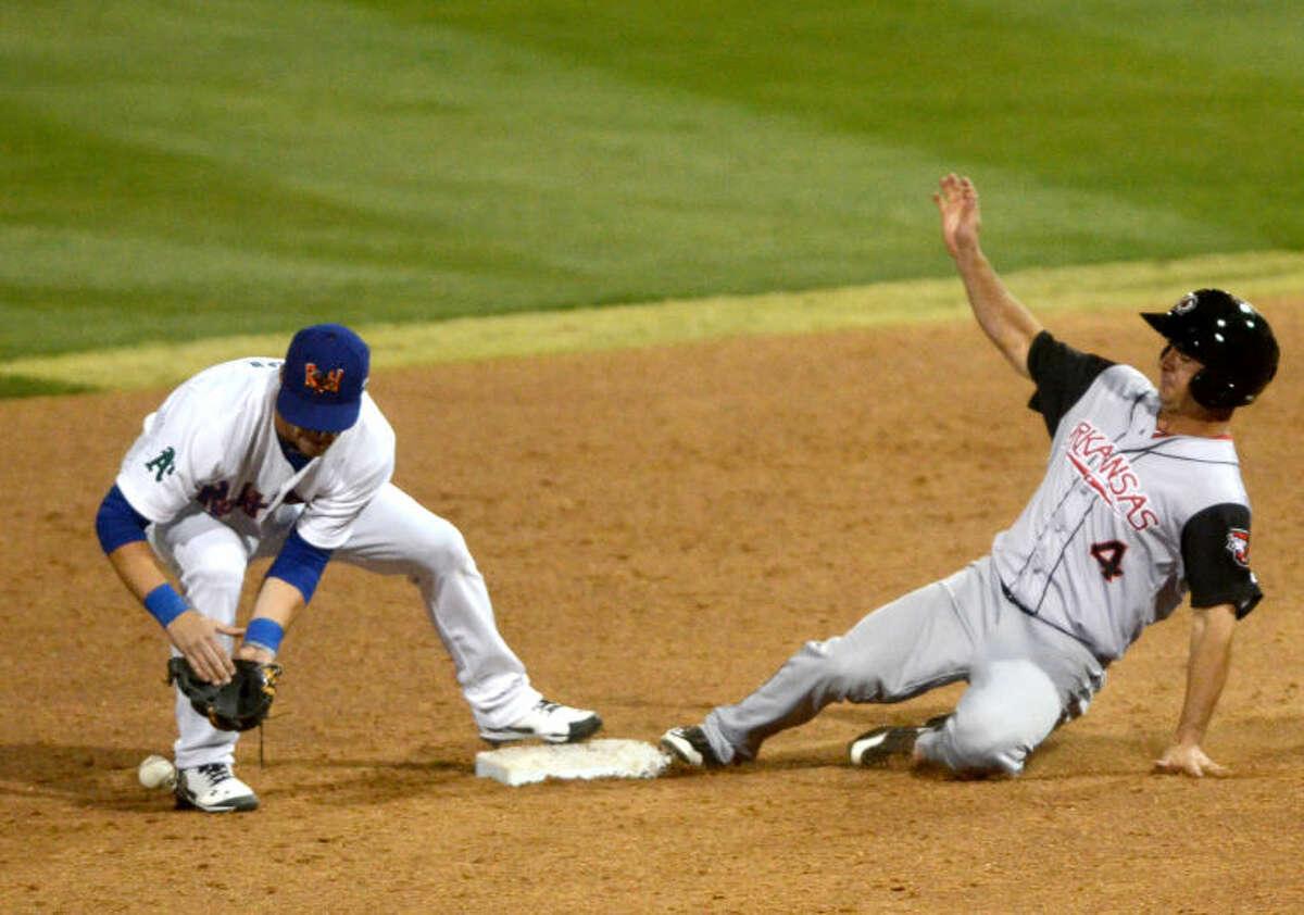 Rockhounds' Dusty Coleman drops the ball as Arkansas Travelers' Andrew Heid slides into second base on Thursday at Security Bank Ballpark. James Durbin/Reporter-Telegram