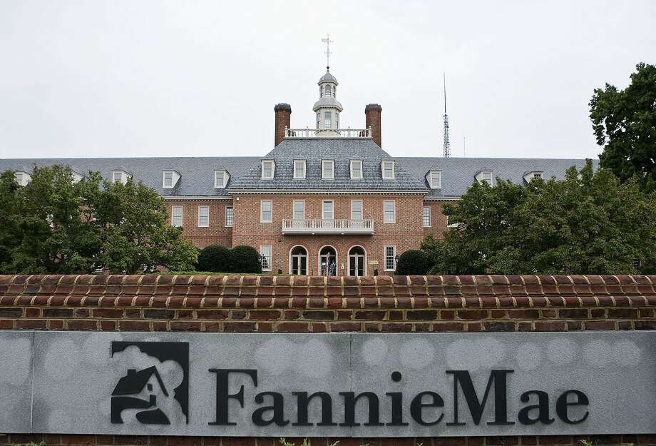 Fannie Mae headquarters stands in Washington, D.C., U.S., on Tuesday, Sept. 8, 2009. Fannie Mae and Freddie Mac, the mortgage-finance companies seized by U.S. regulators a year ago, avoided delisting on the New York Stock Exchange after their shares more than tripled last month. Photographer: Joshua Roberts/Bloomberg Photo: Joshua Roberts, ST