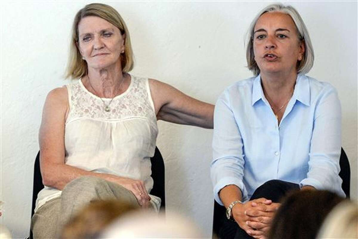 FILE - In this Aug. 27, 2013 file photo Associated Press photographer Anja Niedringhaus, right, and AP journalist Kathy Gannon, are pictured during a visit to the photo agency Keystone in Zurich, Switzerland . Niedringhaus, 48, was killed and Kathy Gannon was wounded Friday, April 4, 2014 when an Afghan policeman opened fire while they were sitting in their car in eastern Afghanistan. Niedringhaus, an internationally acclaimed German photographer, was killed instantly, according to an AP freelancer who witnessed the shooting. Gannon, the reporter, was wounded twice and is receiving medical attention. (AP Photo/Keystone, Walter Bieri, File)