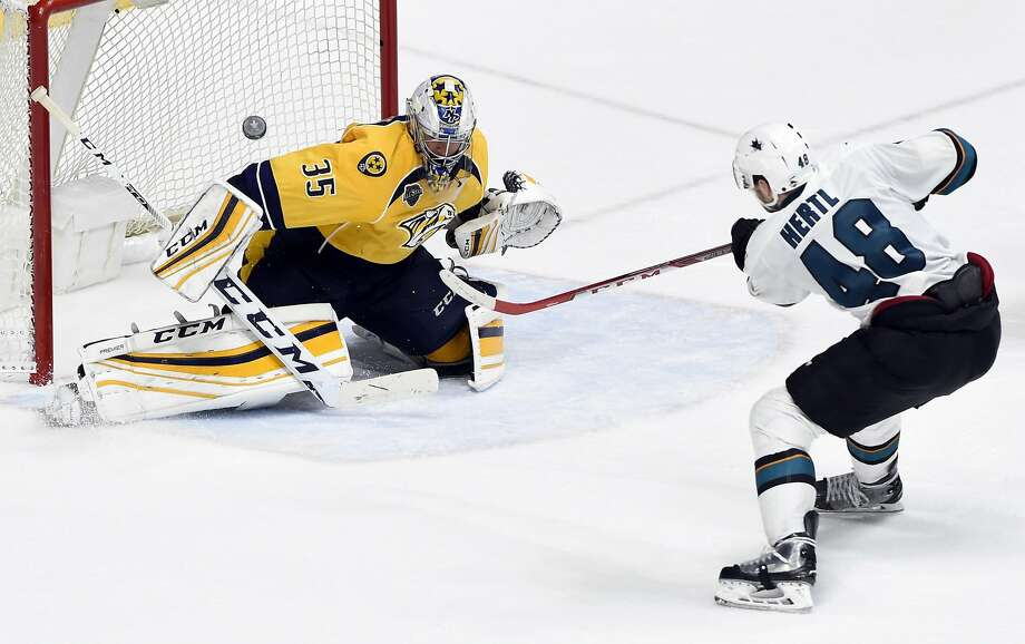 Predators goalie Pekka Rinne deflects a shot by the Sharks' Tomas Hertl in the second overtime of a game that started Thursday night and ended early Friday. Photo: Mark Zaleski, Associated Press