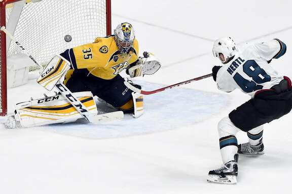 Nashville Predators goalie Pekka Rinne (35), of Finland, blocks a shot by San Jose Sharks center Tomas Hertl (48), of the Czech Republic, during the second overtime period in Game 4 of an NHL hockey Stanley Cup Western Conference semifinal playoff series Friday, May 6, 2016, in Nashville, Tenn. The Predators won 4-3 in triple overtime to even the series 2-2. (AP Photo/Mark Zaleski)