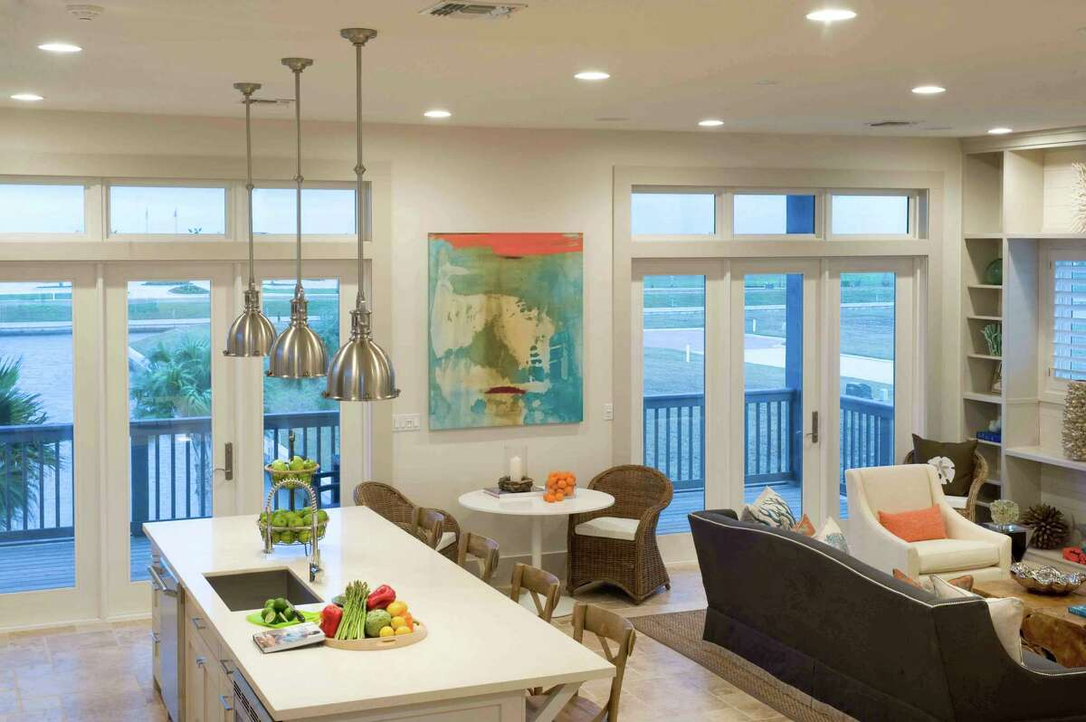 Houston interior designer Courtnay Tartt Elias nurtured a coastal vibe in this beach home, using soft neutrals, accents of blue and pops of orange.
