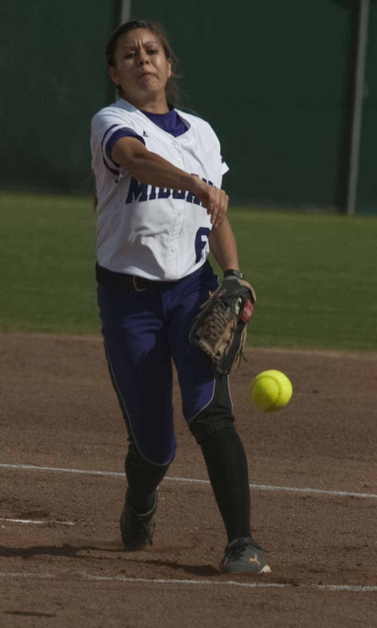 Midland High's Stephani Baeza delivers a pitch Friday against Odessa Permian at Audrey Gill Sports Complex. Tim Fischer\Reporter-Telegram