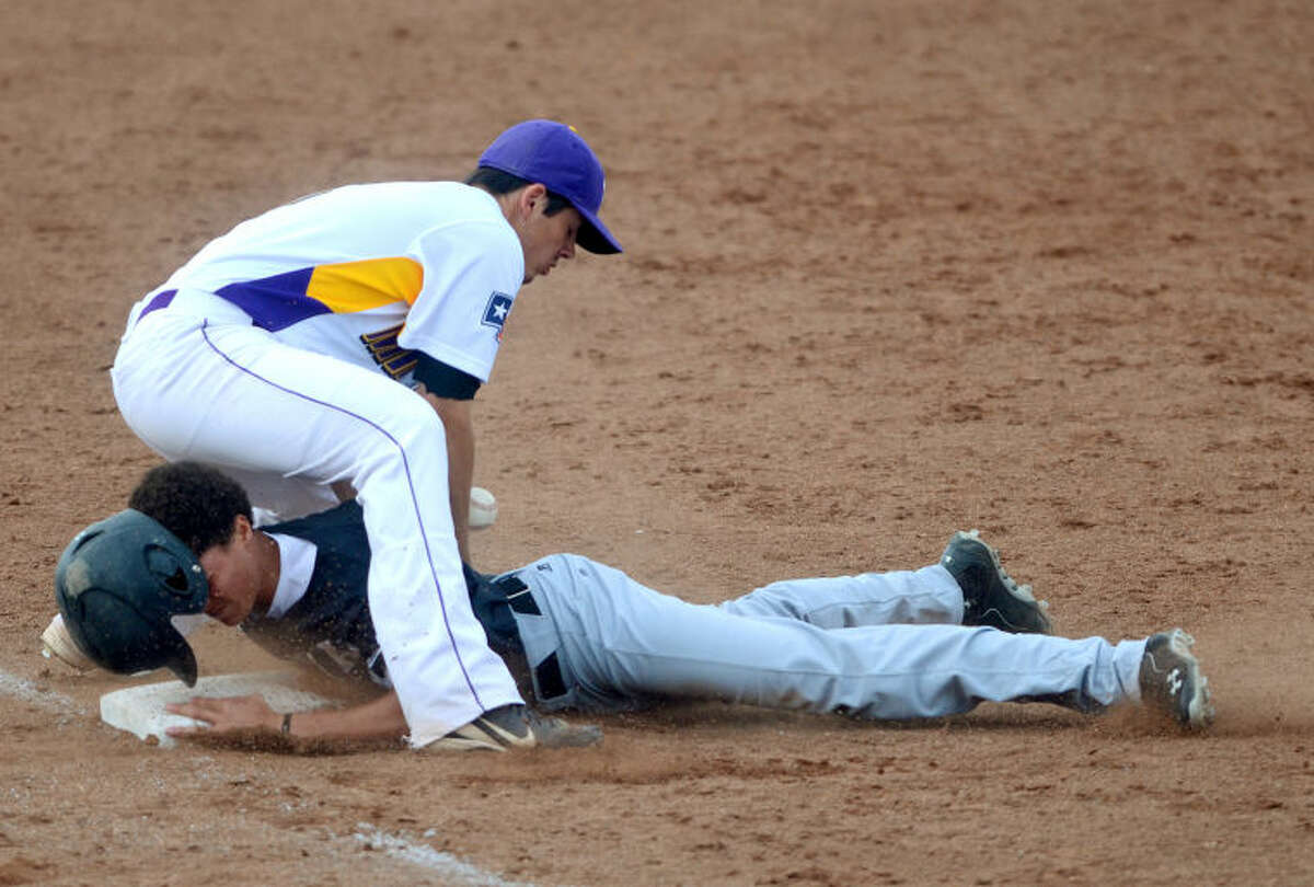 Midland High's Lance White attempts to tag out Permian's Corey Harris as he slides into third base Friday at Zachery Field. James Durbin/Reporter-Telegram