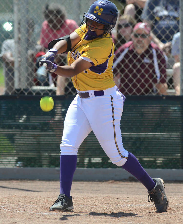 Midland High's Deandra Allen hits against Lee High on Saturday, April 25, 2015, at Audrey Gill Sports Complex. James Durbin/Reporter-Telegram Photo: James Durbin