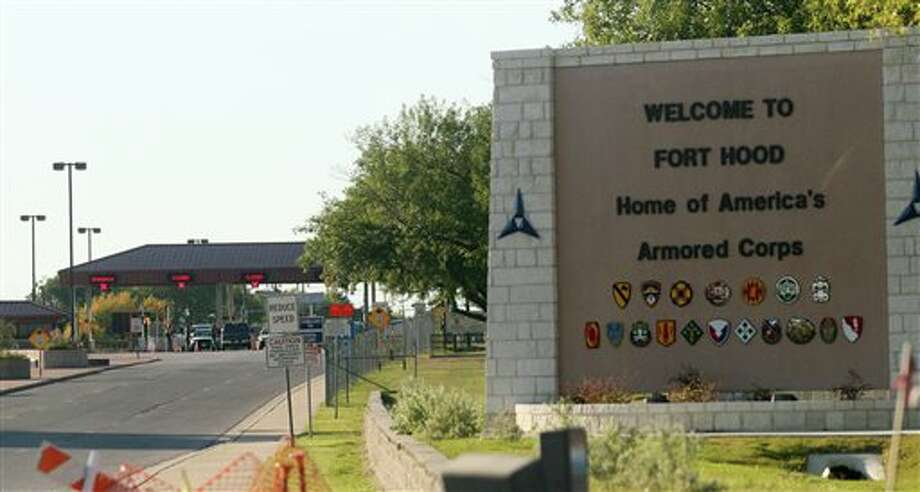FILE - In this Thursday, Nov. 5, 2009, file photo, an entrance is shown to Fort Hood Army Base in Fort Hood, Texas. Fort Hood says there's been a shooting at the Texas Army base and that there have been injuries, on Wednesday, April 2, 2014. (AP Photo/Jack Plunkett) / FR59553 AP