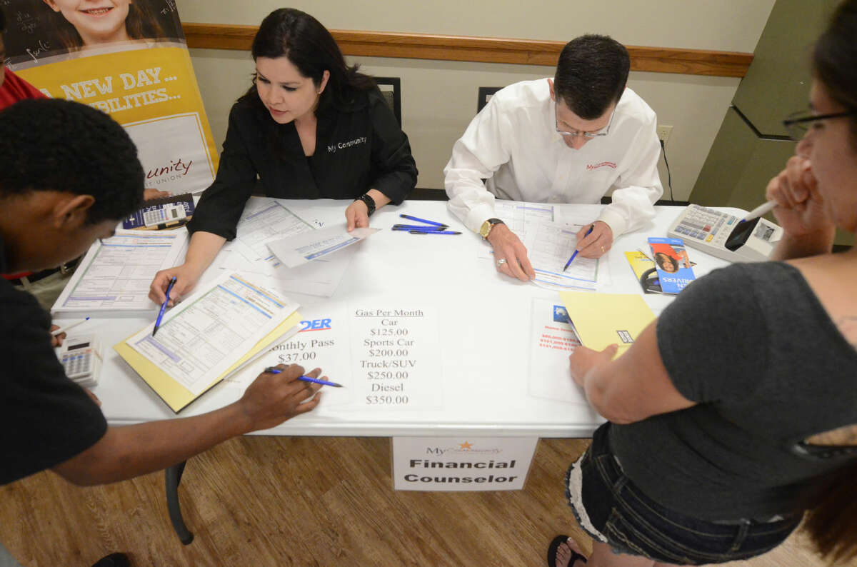 Families involved in Family Promise of Midland participated in a hands-on workforce and financial management training seminar Thursday, May 7, 2015 at Shared Spaces. James Durbin/Reporter-Telegram