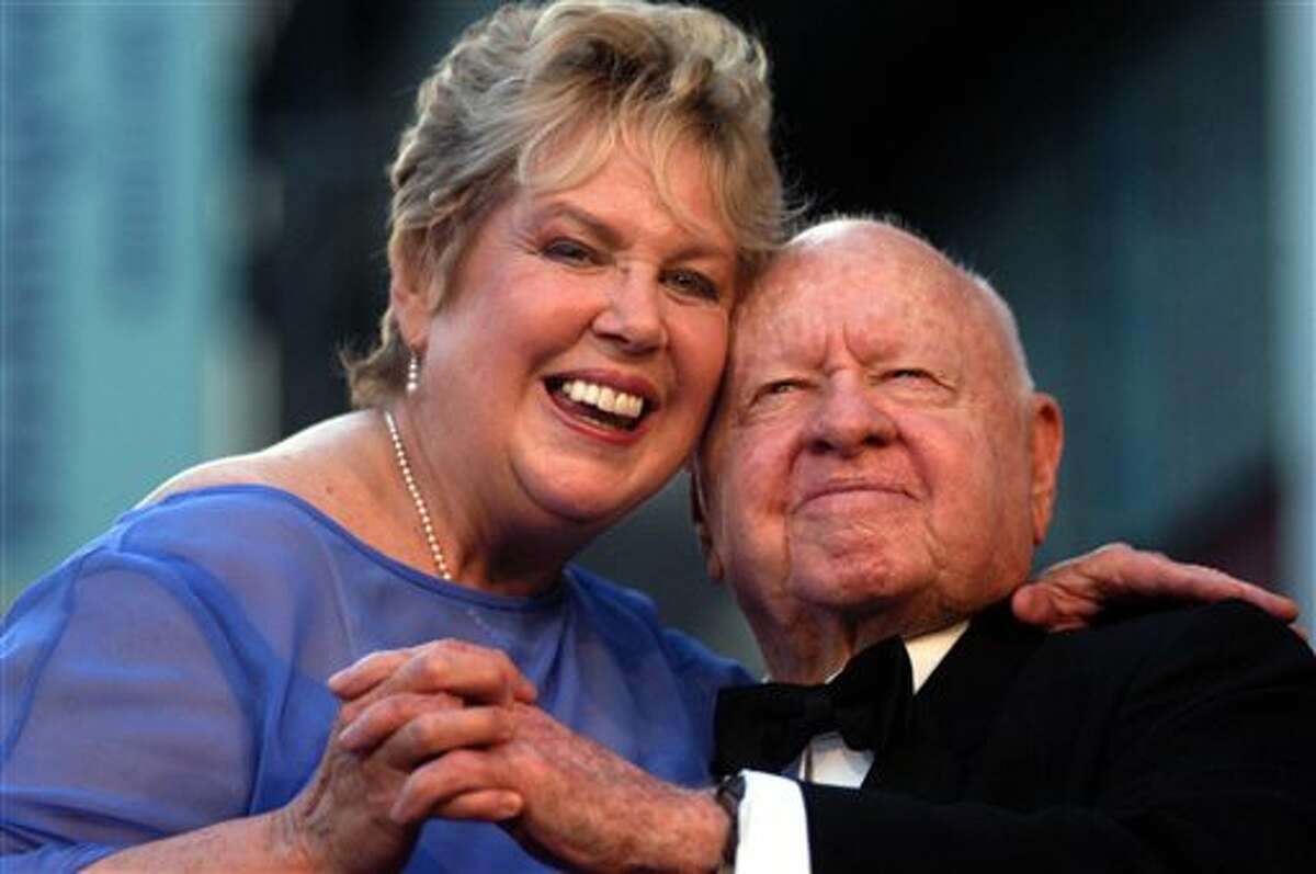 FILE - In this Monday, April 26, 2004, file photo, Jan, left, and Mickey Rooney pose for photographs after having unveiled their star on the Hollywood Walk of Fame in Los Angeles. Mickey Rooney, a Hollywood legend whose career spanned more than 80 years, has died. He was 93. Los Angeles Police Commander Andrew Smith said that Rooney was with his family when he died Sunday, April 6, 2014, at his North Hollywood home. (AP Photo/Ann Johansson, File)