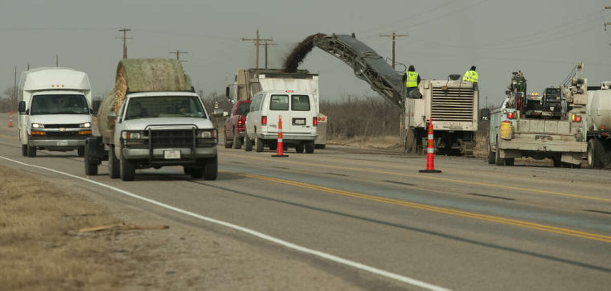 (File Photo) Drivers on Hwy 158 a limited on one lane each way as TxDOT workers resurface the raodway. Tim Fischer\Reporter-Telegram
