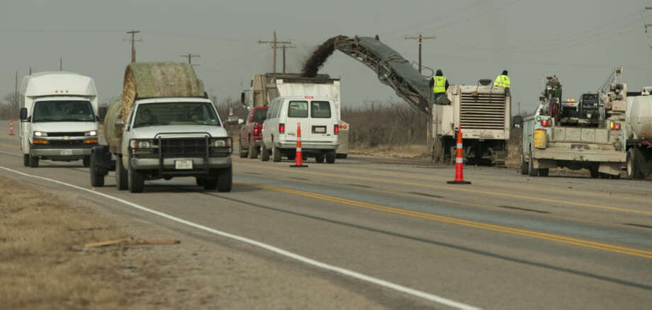 (File Photo) Drivers on Hwy 158 a limited on one lane each way as TxDOT workers resurface the raodway. Tim Fischer\Reporter-Telegram Photo: Tim Fischer