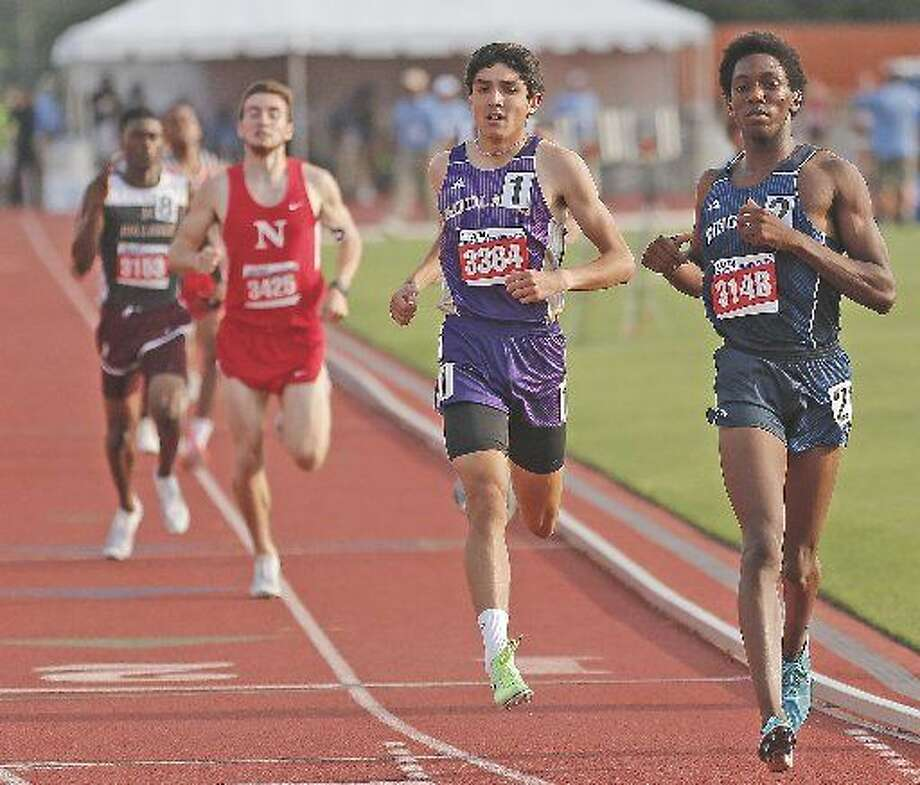 Midland High's Bryce Hoppel runs to a second place finish in the Class 6A 800 meter run, Saturday at the UIL State Track and Field Championships at Mike A. Myers Stadium. Photo: Wade H. Clay|Special To The MRT