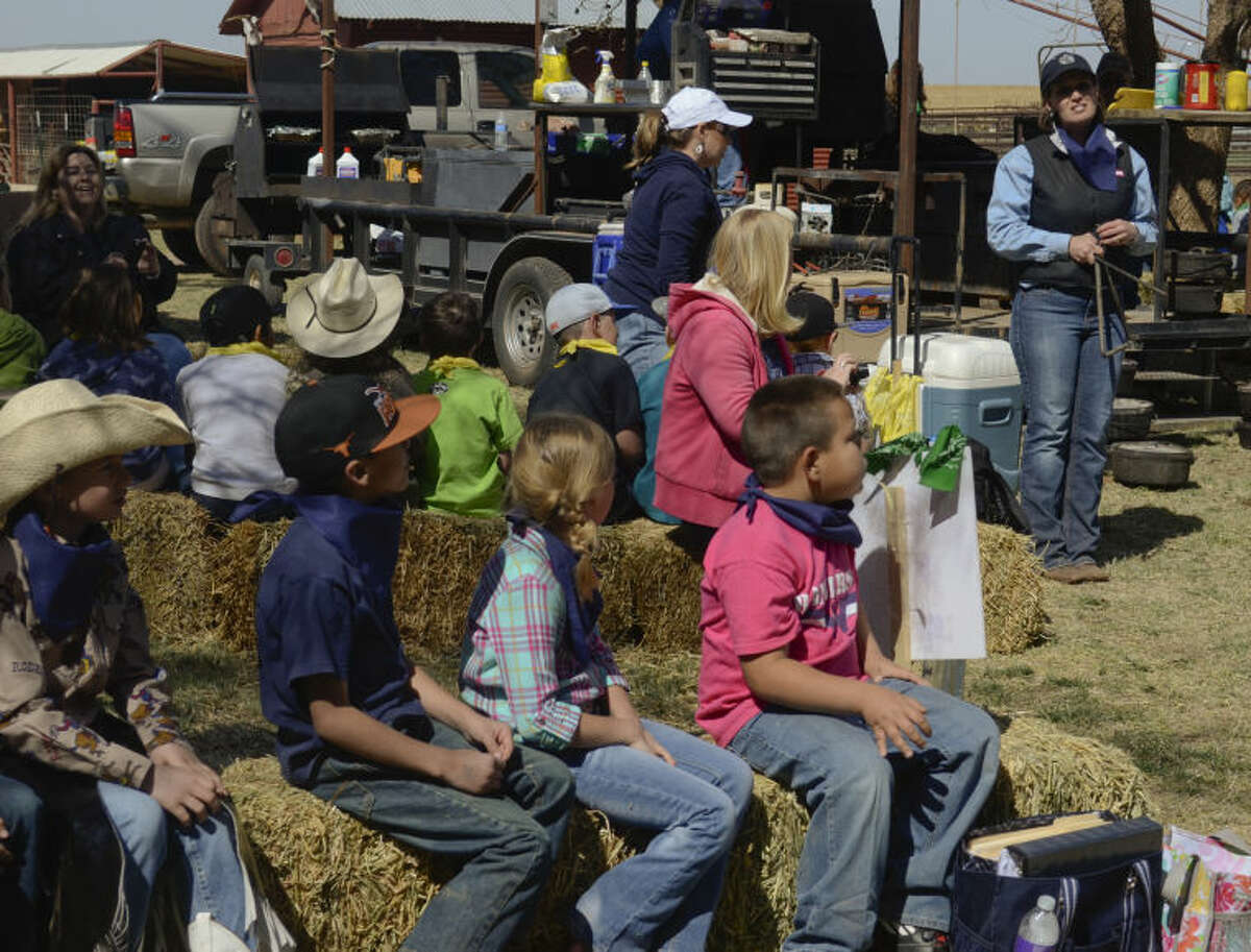 Darla Morrow, right, talks to Greenwood second graders about the chuck wagon team and how they used to travel and serve ranchers Friday during a field trip to her family farm. Tim Fischer\Reporter-Telegram