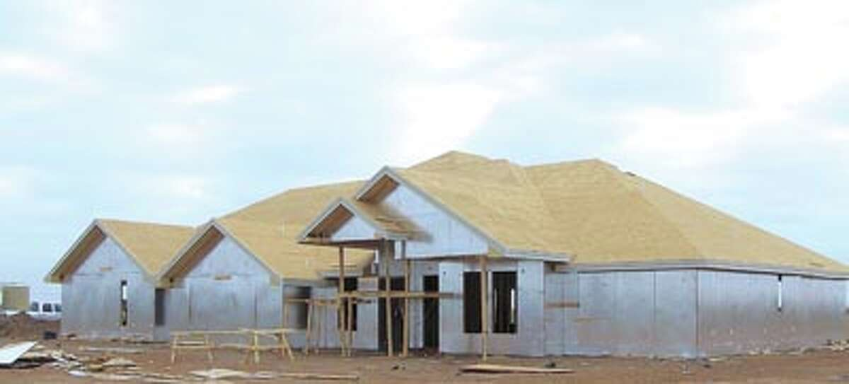 GOING UP This home is just the first of many to spread out across the acres at Champion's Run, east of Greenwood. This gated community will feature 1.5 acre lots, water wells and plenty of fresh air. Call Monty Wheeler of WBC Construction to learn more-432-638-5227.