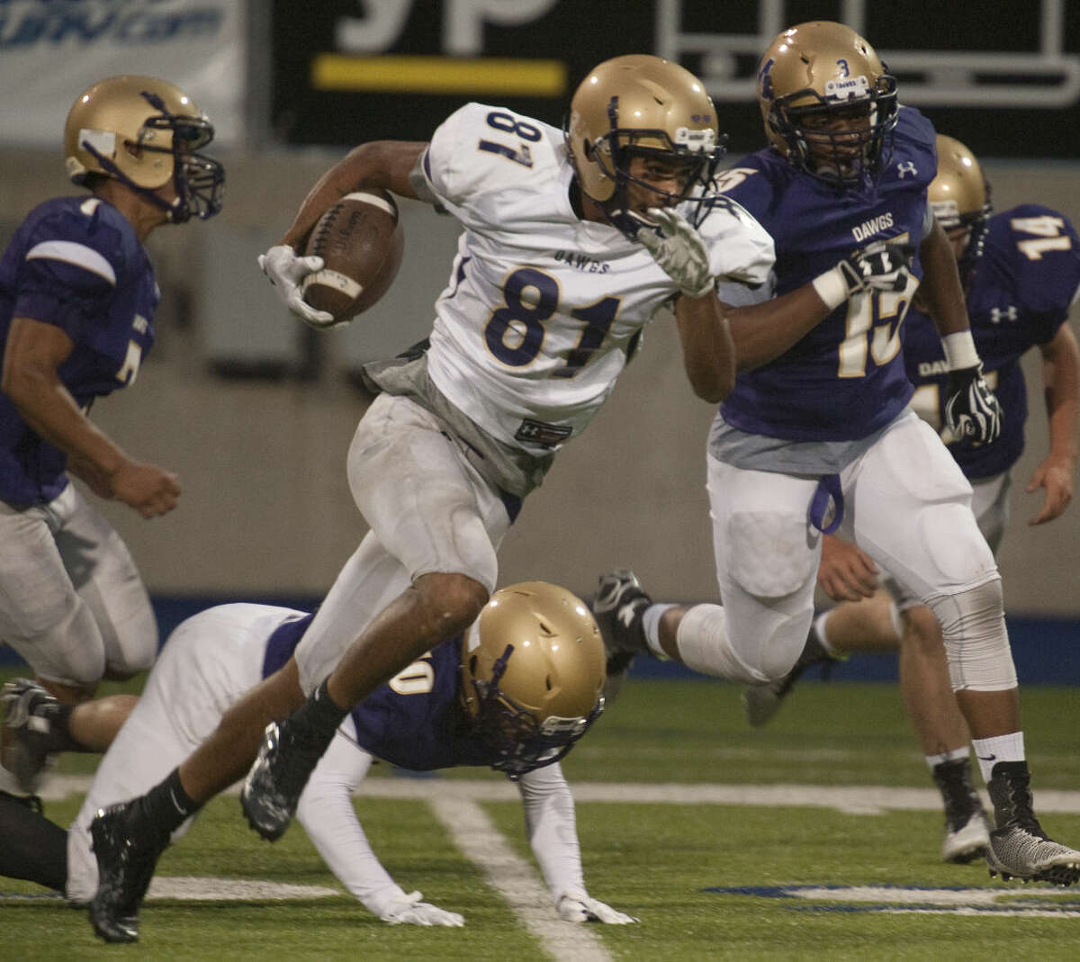 Midland High white team's Courtney McMaryion gets around MHS purple team's Hernan Lujan and other defenders Thursday, 5-21-15, during the Spring game at Grande Communications Stadium. Tim Fischer\Reporter-Telegram