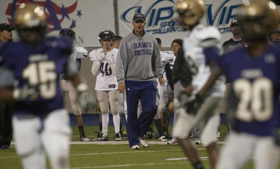Midland High coach Craig Yenzer watches his players Thursday, 5-21-15, during the Spring game at Grande Communications Stadium. Tim Fischer\Reporter-Telegram Photo: Tim Fischer