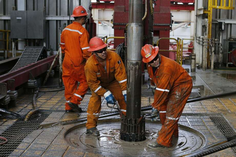 FILE - In this Nov. 22, 2013, file photo, oil workers set the drill on the Centenario deep-water drilling platform off the coast of Veracruz, Mexico in the Gulf of Mexico. The lowest oil prices in nearly six years couldn't have come at a worse time for Mexico, which last year opened up oil-sector investment to private companies for the first time in decades. Slumping oil prices have forced Mexico to slash its 2015 budget with most of the cutbacks expected to come in the energy sector. Analysts predict bids on energy partnerships made possible by Mexico's historic reform will be lower than anticipated (AP Photo/Dario Lopez-Mills, File) Photo: Dario Lopez-Mills