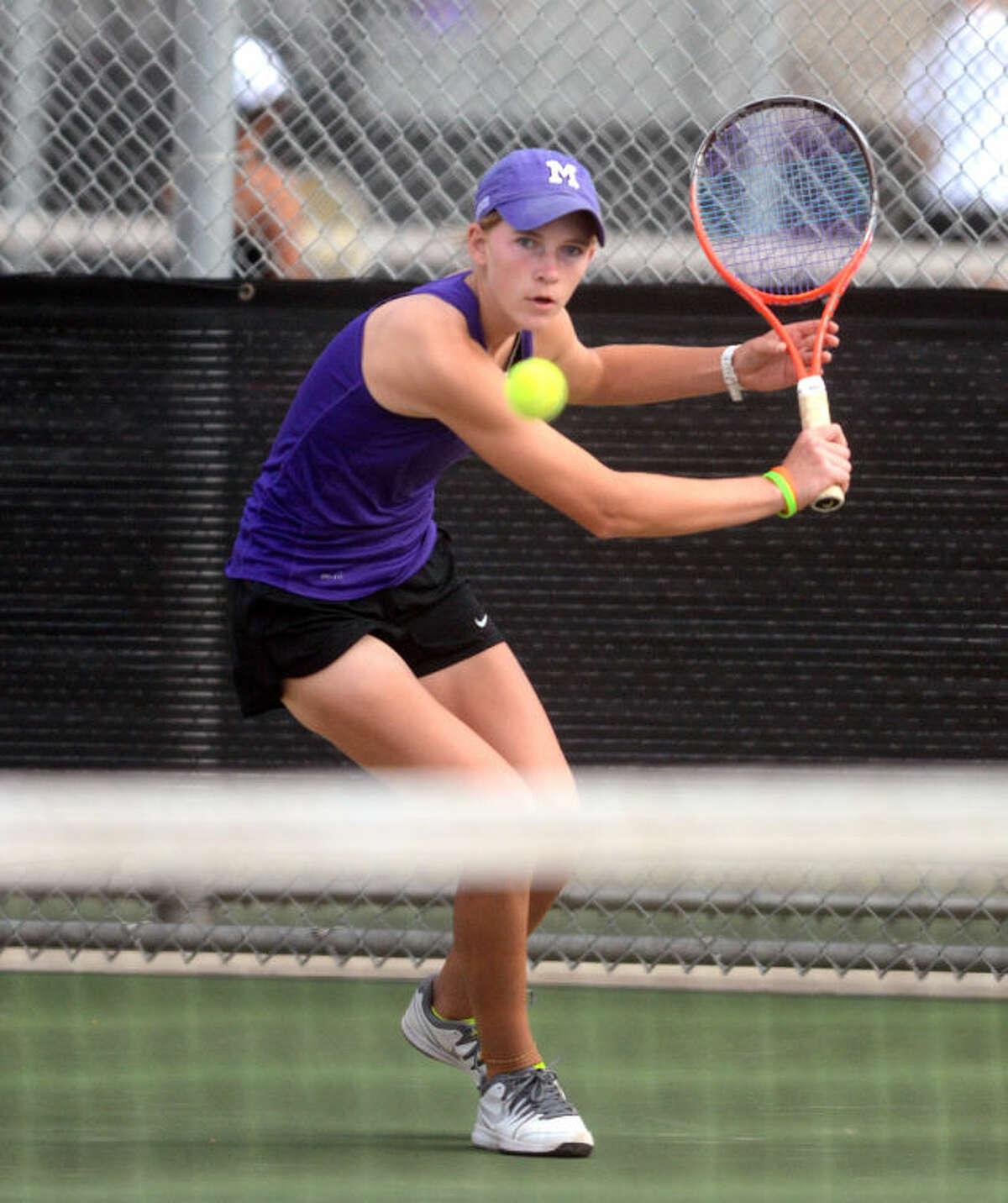 Midland High's Kate Daugherty hits during a District 2-5A Tennis Tournament match Monday at the Bush Tennis Center. James Durbin/Reporter-Telegram