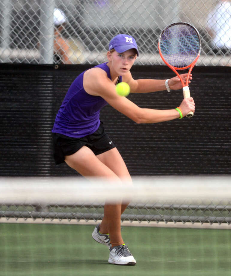 Midland High's Kate Daugherty hits during a District 2-5A Tennis Tournament match Monday at the Bush Tennis Center. James Durbin/Reporter-Telegram Photo: James Durbin