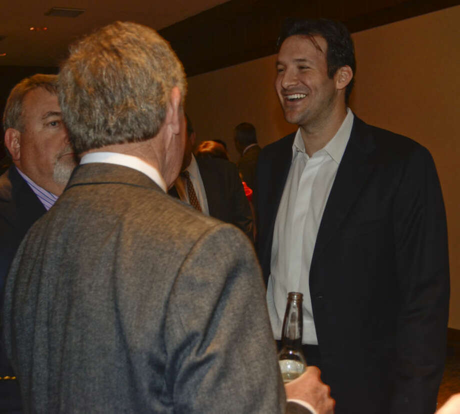 Tony Romo talks with Mike Party and Gary McKinney Tuesday evening before he speaks at the Permian Basin Landman's Association dinner. Tim Fischer\Reporter-Telegram Photo: Tim Fischer