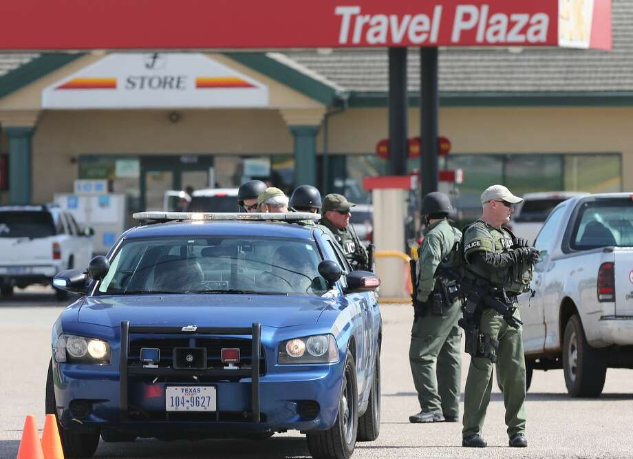 Authorities investigate a shooting in the parking lot of the Twin Peaks restaurant Sunday, May 17, 2015, in Waco, Texas. Authorities say that the shootout victims were members of rival biker gangs that had gathered for a meeting. (AP Photo/Jerry Larson) Photo: Jerry Larson