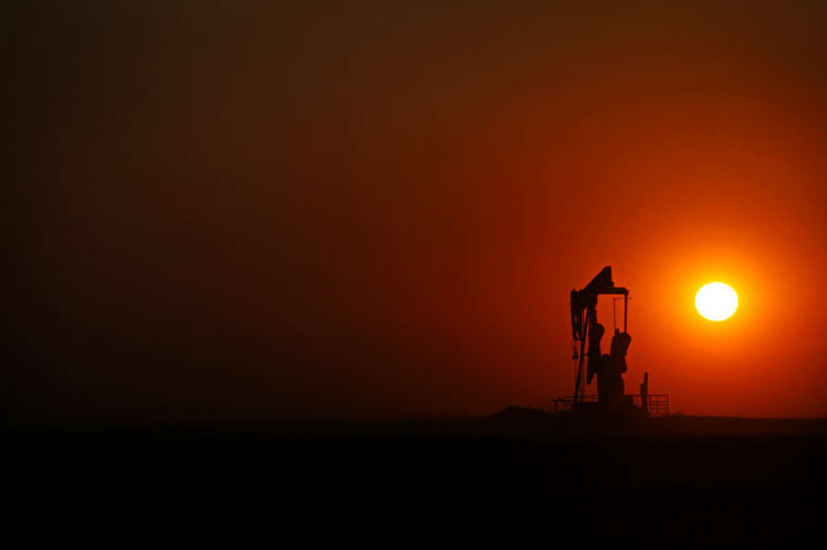 The sun sets behind a pumpjack near FM 829 in Stanton in 2014. James Durbin/Reporter-Telegram