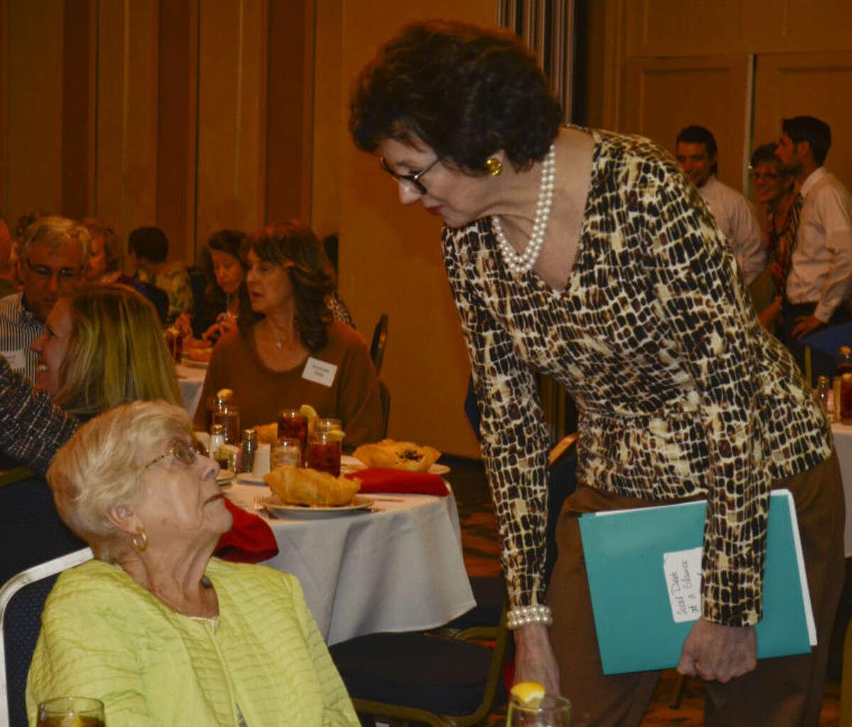 Susan Combs talks with former Judge Barbara Culver Clack Wednesday before the Midland County Republican Women's luncheon. Tim Fischer\Reporter-Telegram