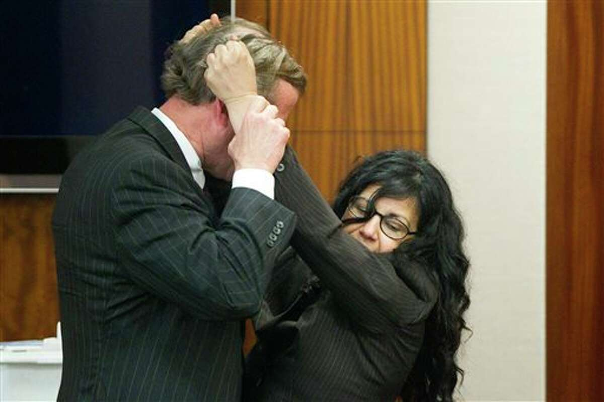 Defense attorney Jack Carroll, left, and Ana Trujillo demonstrate the fight that led to a fatal stabbing as she testifies during the punishment phase of her trial on Thursday, April 10, 2014, in Houston. Trujillo, convicted of murder for fatally stabbing her boyfriend 59-year-old Alf Stefan Andersson with a 5 ½-inch stiletto shoe heel, told the jurors she killed him in a desperate attempt to save her own life during a brutal fight of more than an hour in which she was chased down, knocked into a wall and thrown over a couch. (AP Photo/Houston Chronicle, Brett Coomer) MANDATORY CREDIT