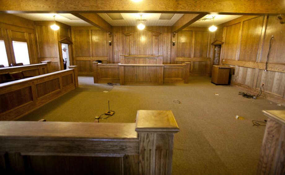Judge Darr's old courtroom was one of the many rooms within the former courthouse building that look nearly untouched. Each courtroom is worth about $100,000, Painter said. The judge's bench in each room is bullet-proof, he added. Photo: James Durbin
