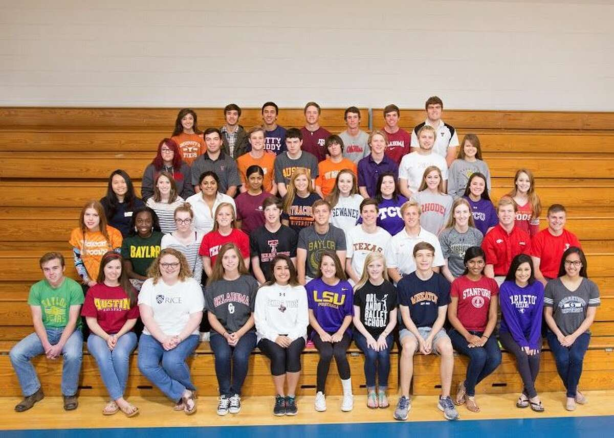 Members of Trinity School's Class of 2015 wear T-shirts from the college or university they plan to attend.