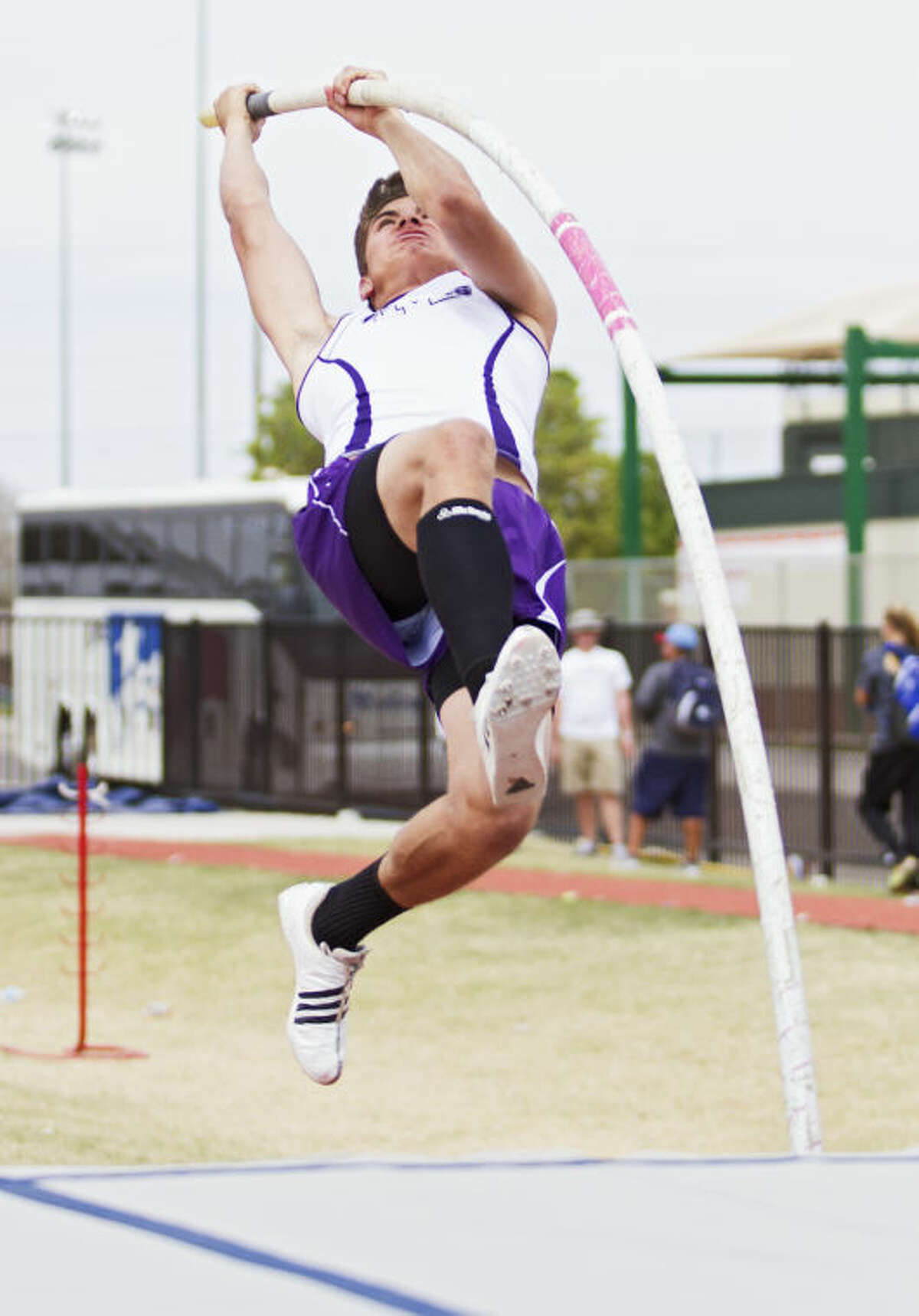 Midland's Kaleb Slack vaults into the air during his first place attempt during the UIL District 2-5A Track Championship on Thursday at Lowrey Field in Lubbock. Slack finished in first place after clearing the 13 foot bar.