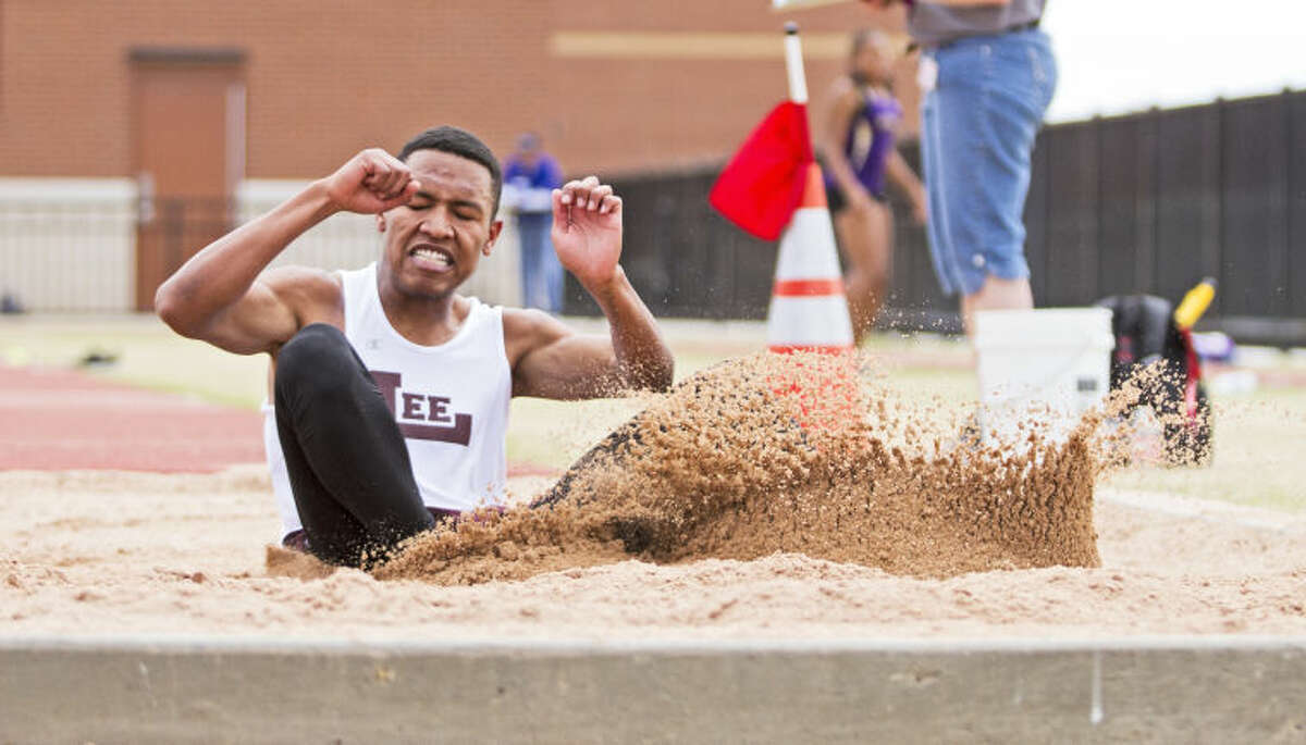 Midland Lee's Ian Johnson lands in the sand pit during his long jump during the UIL District 2-5A Track Championship on Thursday at Lowrey Field in Lubbock. Johnson's first place 21' 10-1/4
