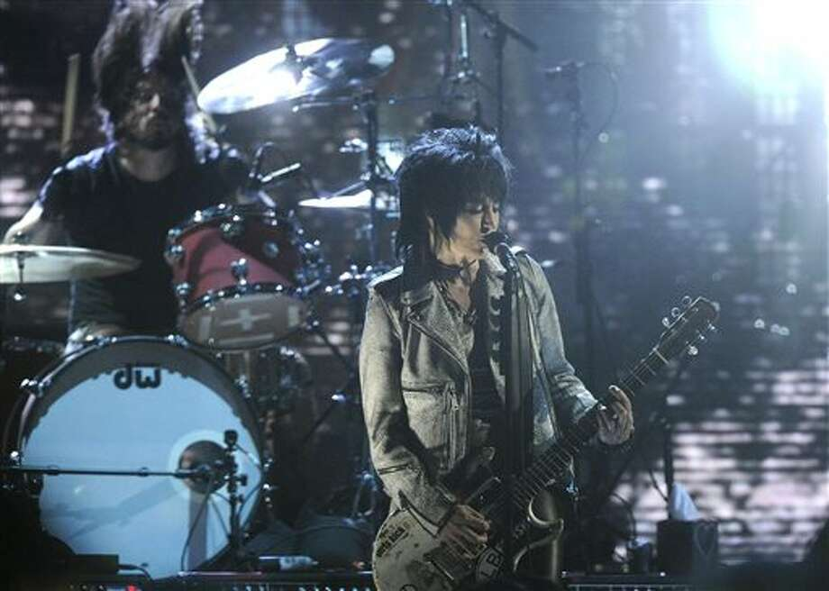 Hall of Fame Inductee Dave Grohl and Joan Jett perform at the 2014 Rock and Roll Hall of Fame Induction Ceremony on Thursday, April, 10, 2014 in New York. (Photo by Charles Sykes/Invision/AP) Photo: Charles Sykes / Invision